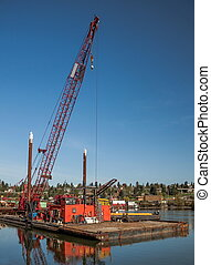 Cargo crane on a barge - %u0421argo crane on a barge in the...