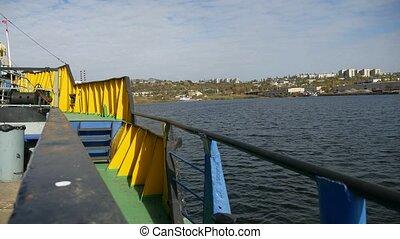 cargo cranes Bay sea barge boat bridge a small water town -...