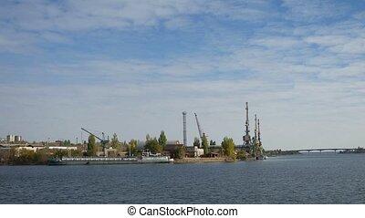 cargo cranes Bay sea barge boat bridge a small town water -...