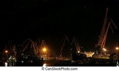 Cargo cranes in a harbor