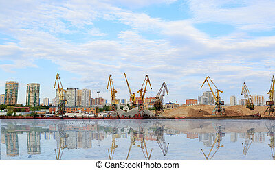 Cargo cranes in port terminal . The shore of the river Moscow.