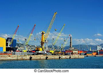 Cargo cranes with warehouse in Genova sea industrial port