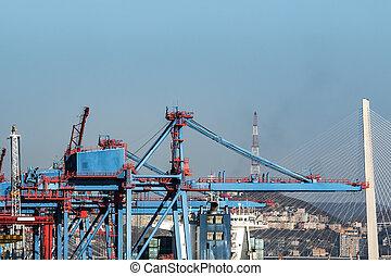 cargo cranes working in the port
