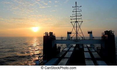 cargo ferry at sunset