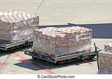 cargo, freight airpo - 3 large packages wait for the...