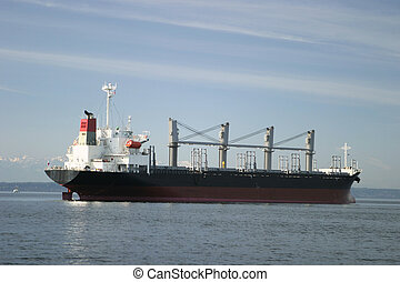 Cargo Freighter - A cargo freighter, at anchor, in the...