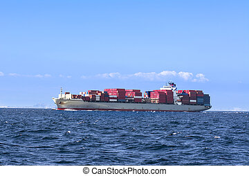 A freighterloaded with cargo containers leaves the port of Long beach, california.