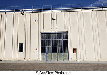 Cargo gate of Industrial warehouse. Industrial door. View on the one gates of big warehouse facade. Front view