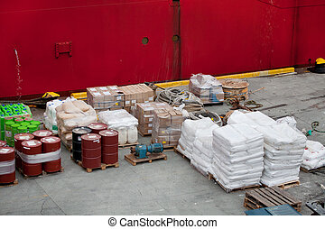 Cargo in harbor - Cargo in cargo with boxes ropes and cans