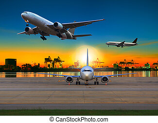 cargo plane flying over airport against beautiful morning light in ship yard use for transportation and logistic industry business
