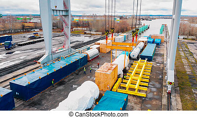 Cargo port - A big industrial crane loading the cargo on the freight carriages