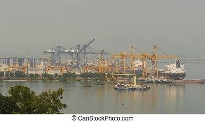 Cargo port in the work. Ha Long Bay. Vietnam. (Shot in 4K -...