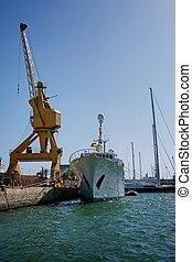 Cargo ship against blue sky