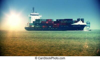 Cargo ship and boat at sundown