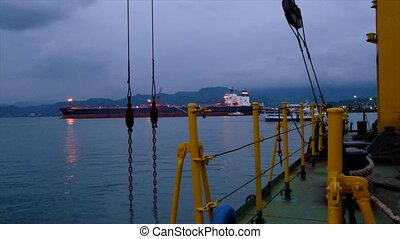 Cargo ship and floating tourist boat in Batumi port