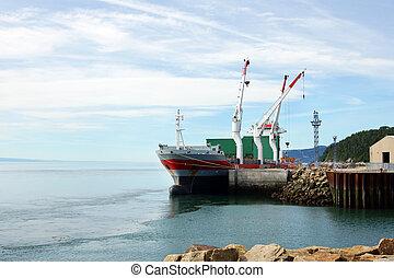 Cargo ship at small dock