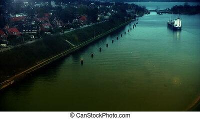Cargo ship at sundown in Kiel Canal