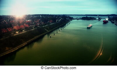 Cargo ship at sunset in Kiel Canal