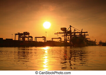 Cargo ship at the port  sunrise