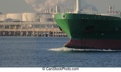 Large cargo ship bulbous bow design visible in the front, slow motion from 60 fps