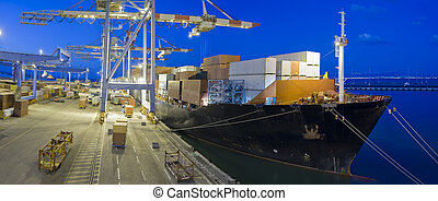 cargo ship by night - cargo ship at dock by night panorama