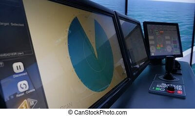Cargo ship cabin with modern navigation equipment in the...