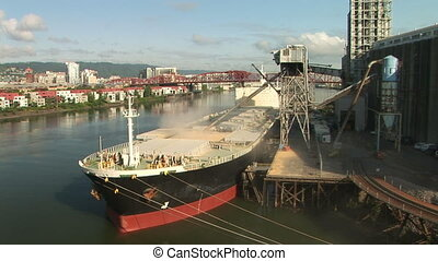 Cargo ship being loaded up. Docked on the Willamette river in Portland, Oregon.