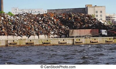 Cargo ship carries garbage in the sea. Slow motion. Garbage...