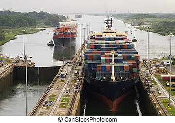 Cargo Ship in Panama Canal - Several freighters, assisted by...