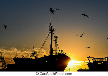 cargo ship in sea at sunset, photo as background