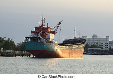 Cargo ship in the harbor at sunset, Thailand