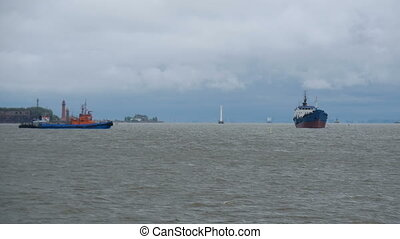 Cargo ship is at sea in a storm