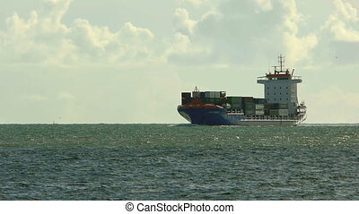 Large cargo ship approaches the harbour of Lisbon.
