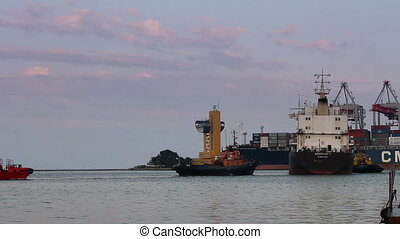 Cargo ship leaves port with tug assistance (Full HD)