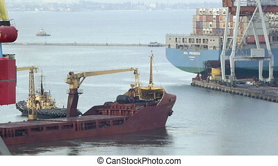 Cargo ship leaves port with tugs assistance timelapse