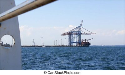 Cargo Ship Loading In Port - Crane loads containers on a...