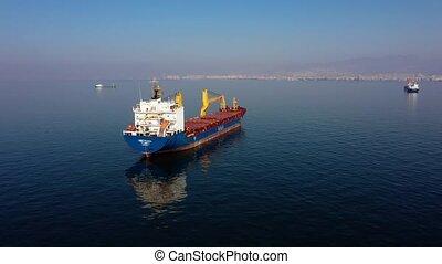 Cargo ship moving in calm sea.