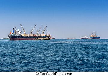 Cargo ship on sea.