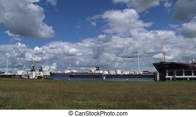 Cargo ship, rhine barge sailing in Port of Amsterdam