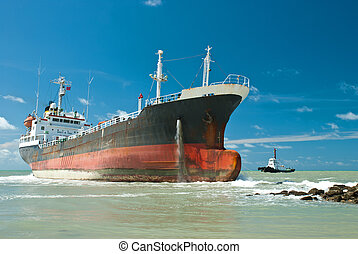 Cargo ship run aground on rocky shore
