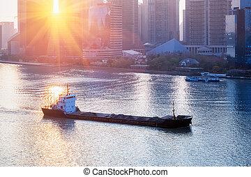cargo ship sailing in shanghai