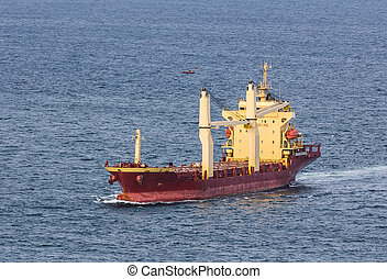cargo ship sailing on the sea