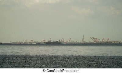 Cargo ship sails on the sea. Philippines, Manila.