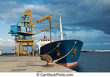 Cargo ship - Ship moored down by the jetty, and a sort off ...