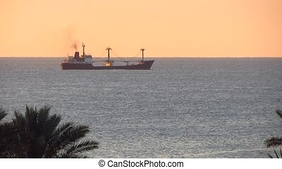 Cargo ship - Tanker ship at sea at sunrise