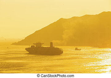 Cargo ship under sunset