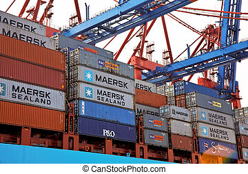 cargo ship with containers in the port of hamburg -...