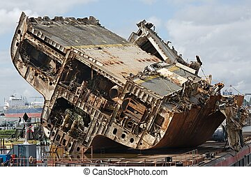 Cargo ship wreck - Huge ship wreck in industrial dock