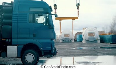 Cargo shipping - a big shipping truck arriving on the construction site