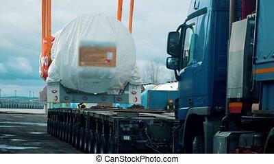 Cargo shipping - a big truck approaches under the cargo